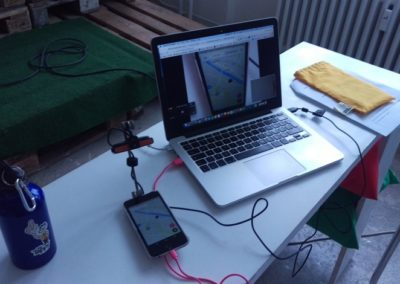 UX designer gets ready to usability test a mobile app using a device mounted camera - Mr. Tappy